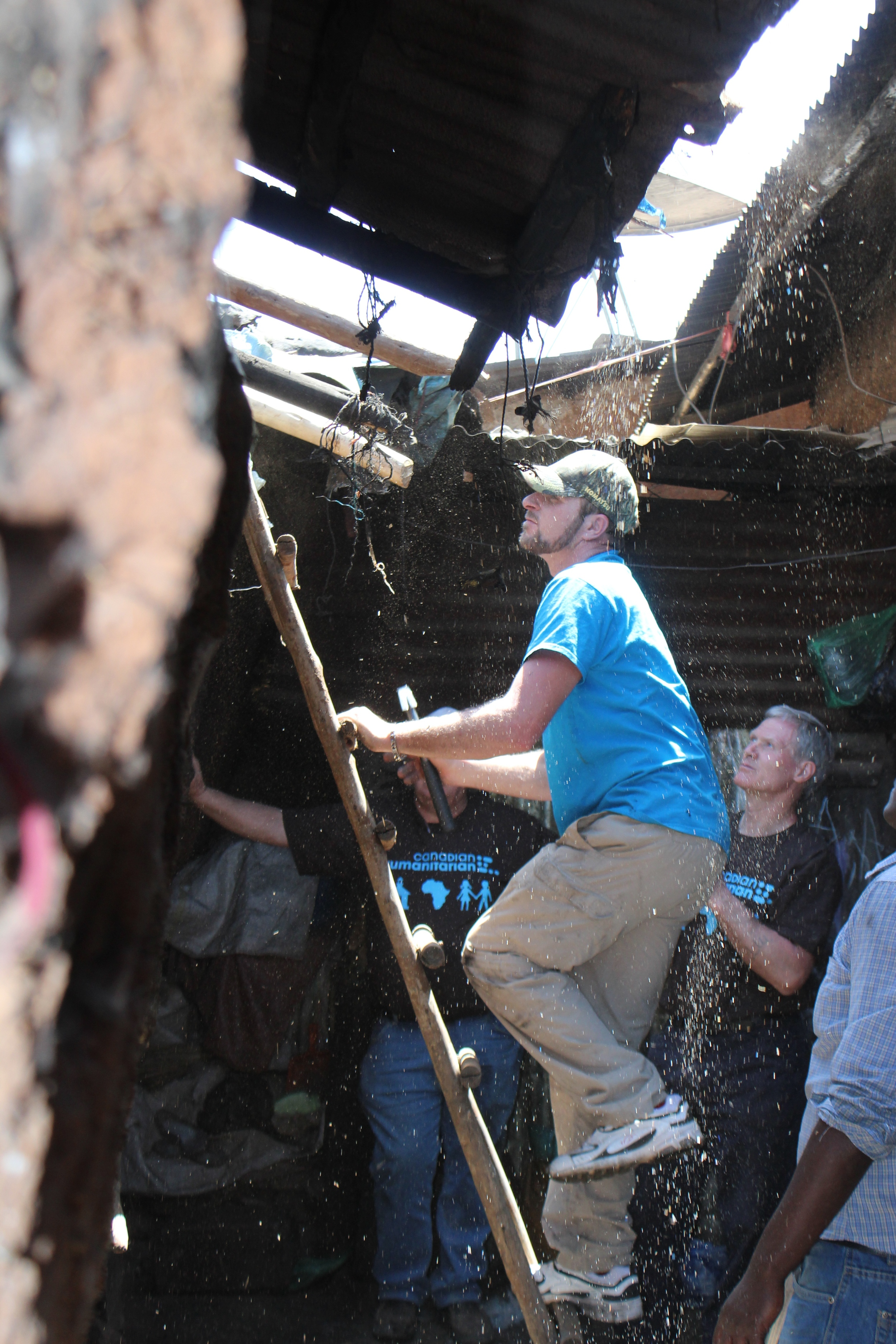 The roof comes off with a shower of debris - wood shavings, rat feces, soot and cinders, over Murray, Pete and Frank.
