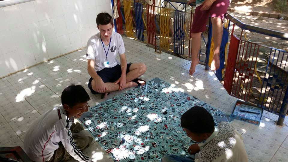 Aidan and Brennan use a game to teach English skills to their students during class time.