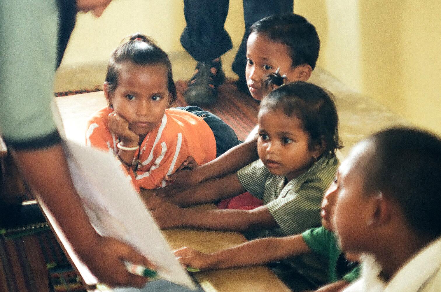 Students in Rajbanshi MLE schools reading Big Books.