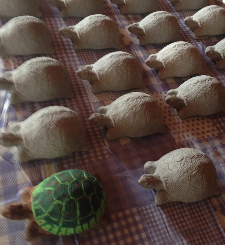 concrete turtles ready for painting