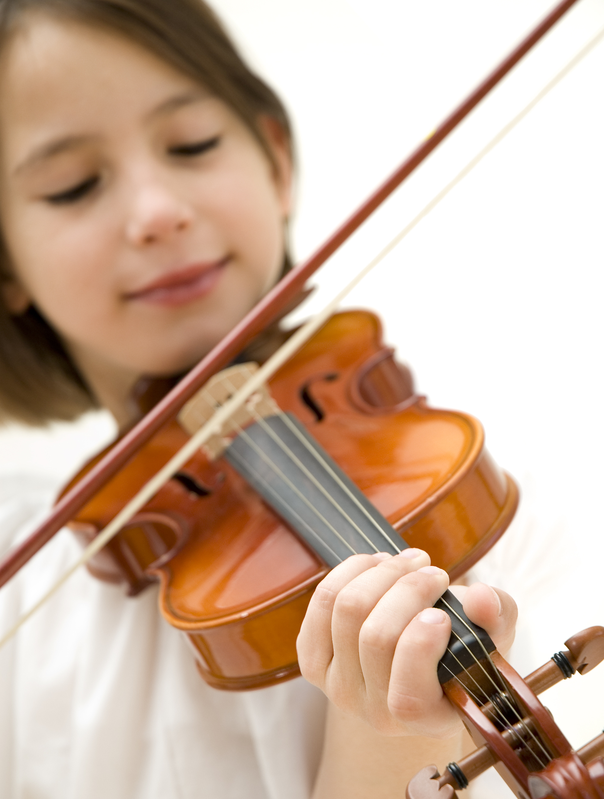 young girl with violin focused on hand isolated on white