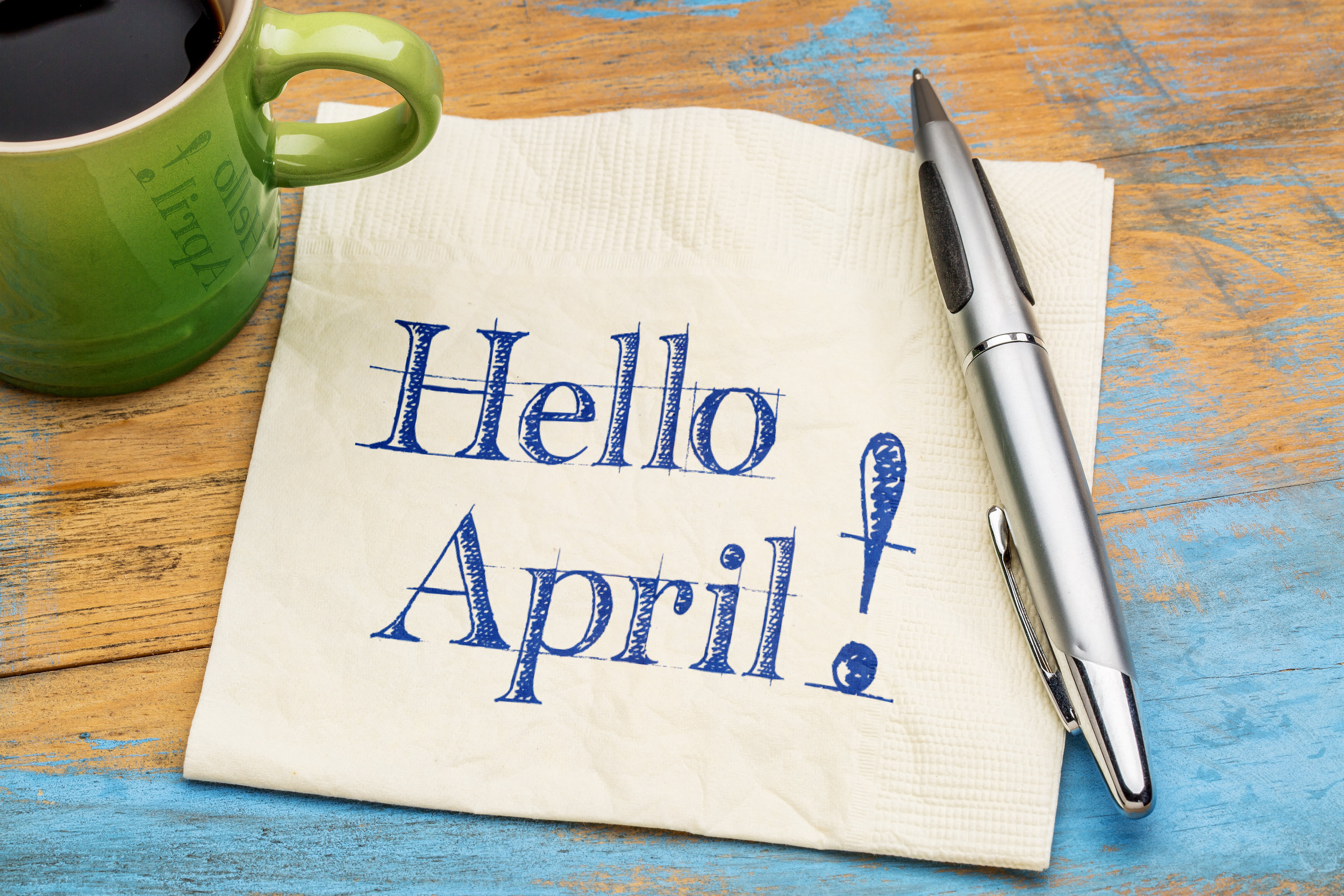 Hello April on napkin with coffee