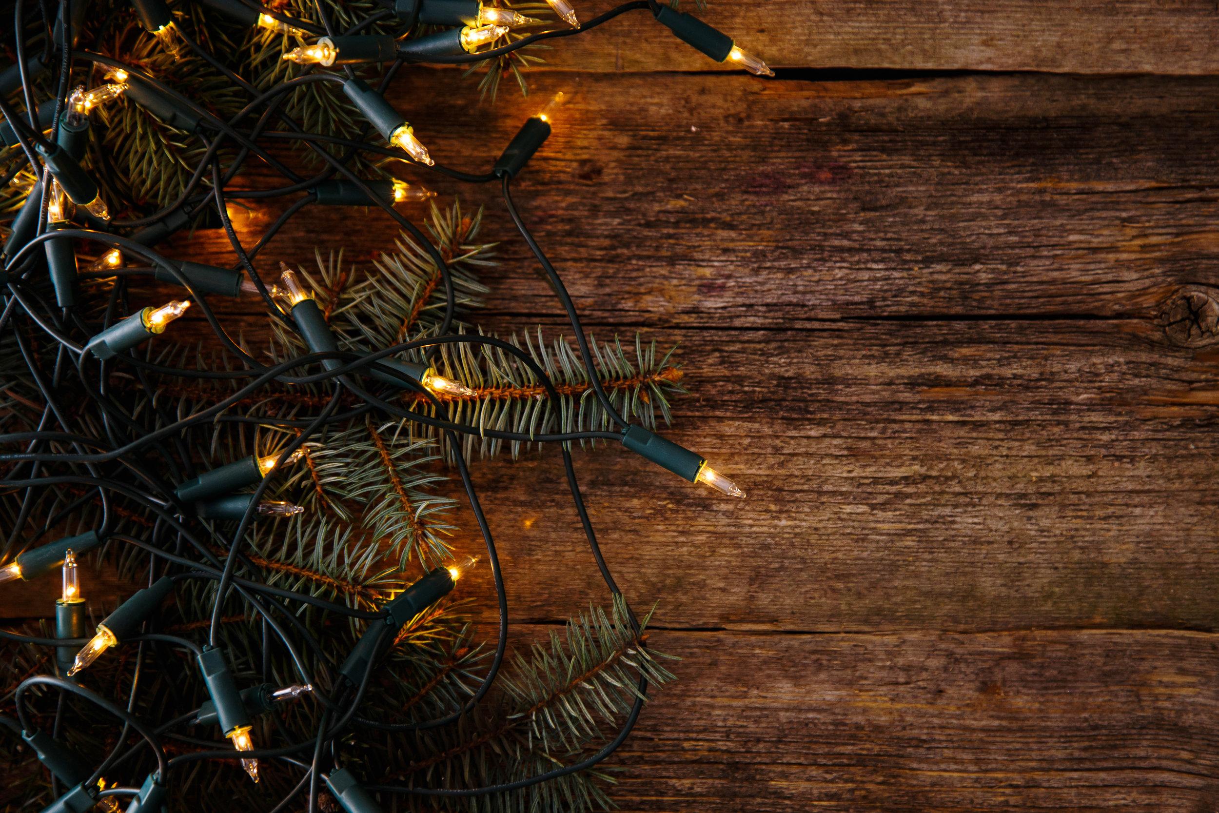 Christmas. Fir with garland on the table