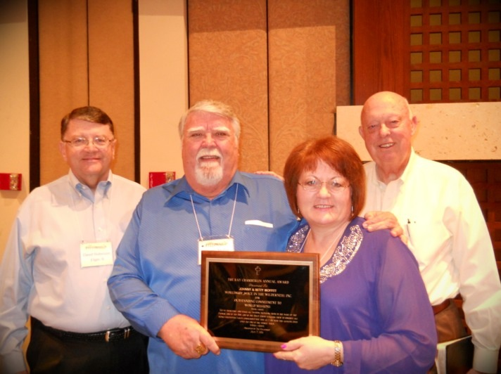"""WVIW Honored by The Fellowship  July Johnny and Betty Moffitt were named """"Missionaries of The Year"""" by The Full Gospel Fellowship of Churches and Ministers, International"""" , at their annual conference in Scottsdale, Arizona. Pictured with Johnny and Betty are Dr. David Robinson, Chairman of The Fellowship Missions Department, and Dr. Gene Evans, President of The Fellowship.   Johnny and Betty were given this award for over thirty years of """"Outstanding Commitment to World Missions"""". They want to say """"Thank You"""" to The Fellowship and especially to the countless volunteers and partners of Worldwide Voice in the Wilderness, for years of faithful service and support."""