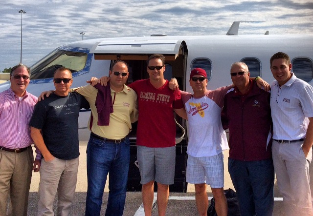 Elite Air CEO and pilot Gray Gibbs (far left) flew five passengers to the FSU-Miami game on Nov. 2 along with pilot Blake Spencer (far right). The flight was donated as part of a charity auction in October.