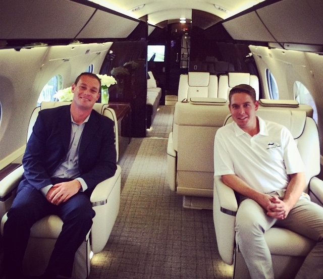 The annual National Business Aviation Association Conference includes a large static display of aircraft that attendees have the opportunity to tour. Elite Air Sales Director AJ Becker (left) and Lear 31 Captain Blake Spencer (right) are shown here aboard a Bombardier Challenger 605, an industry leading heavy jet.