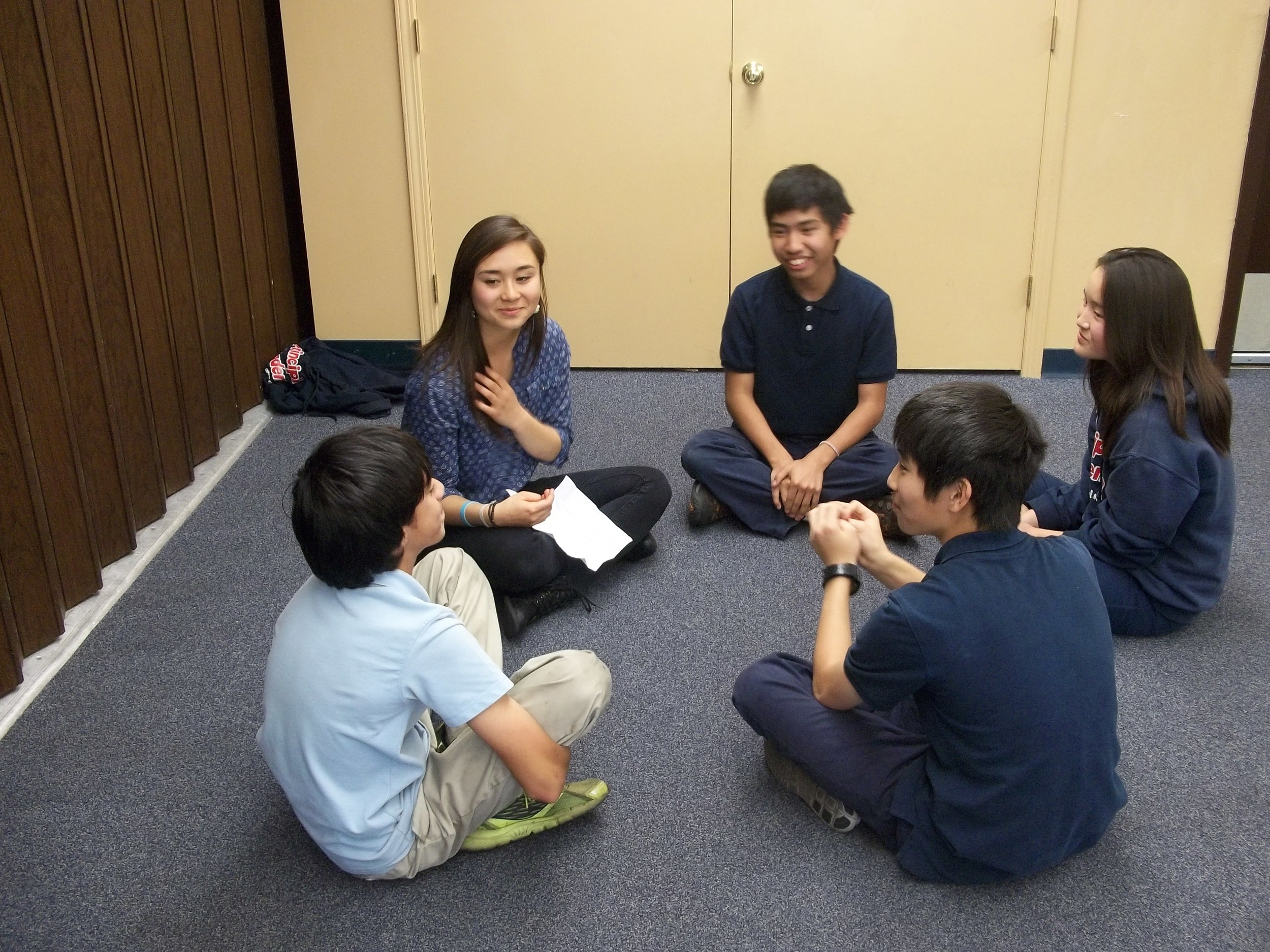Hana leading a group talk