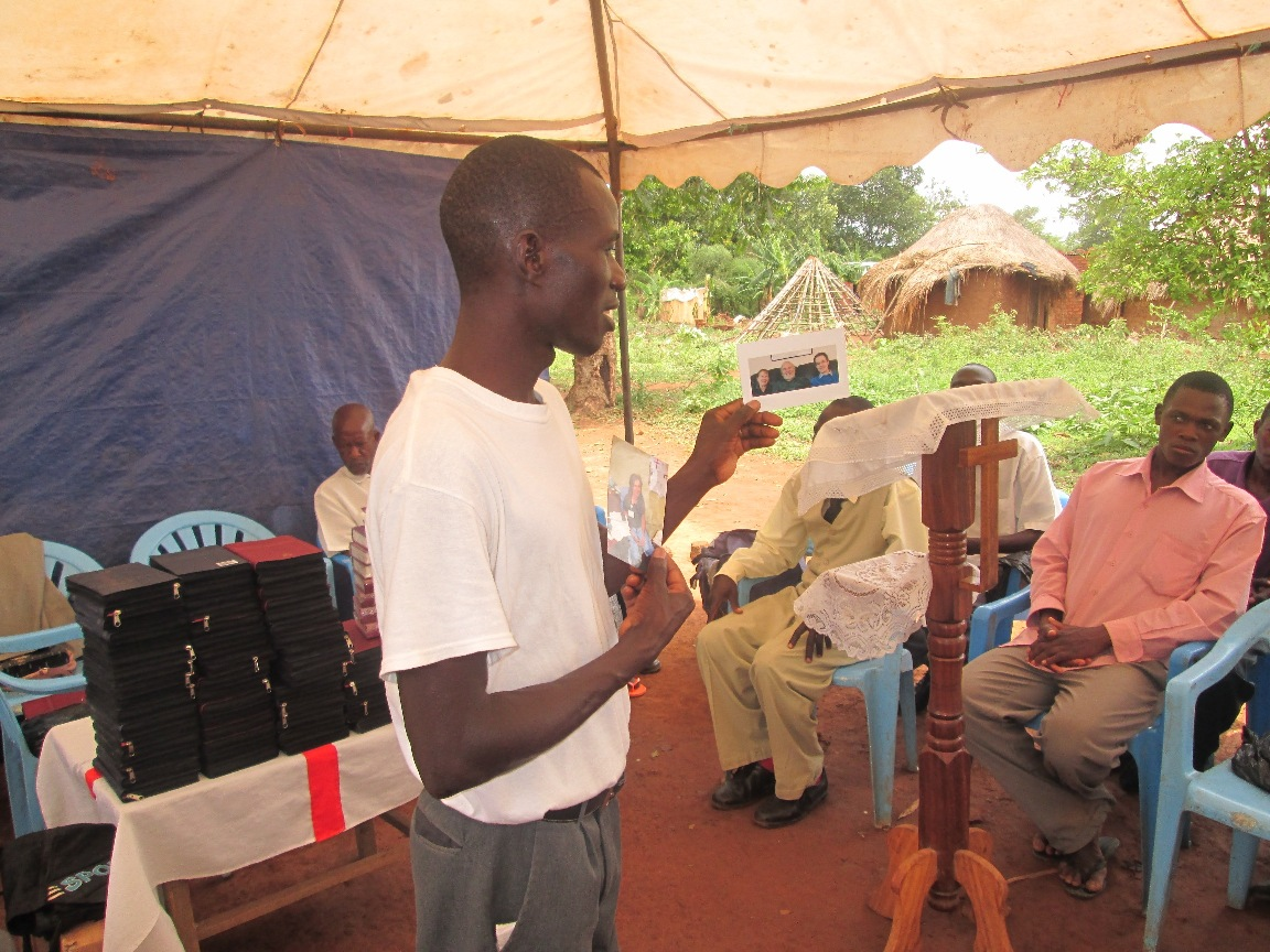 """Pastor Jimmy explaining how """"Bibles for Uganda"""" operates"""