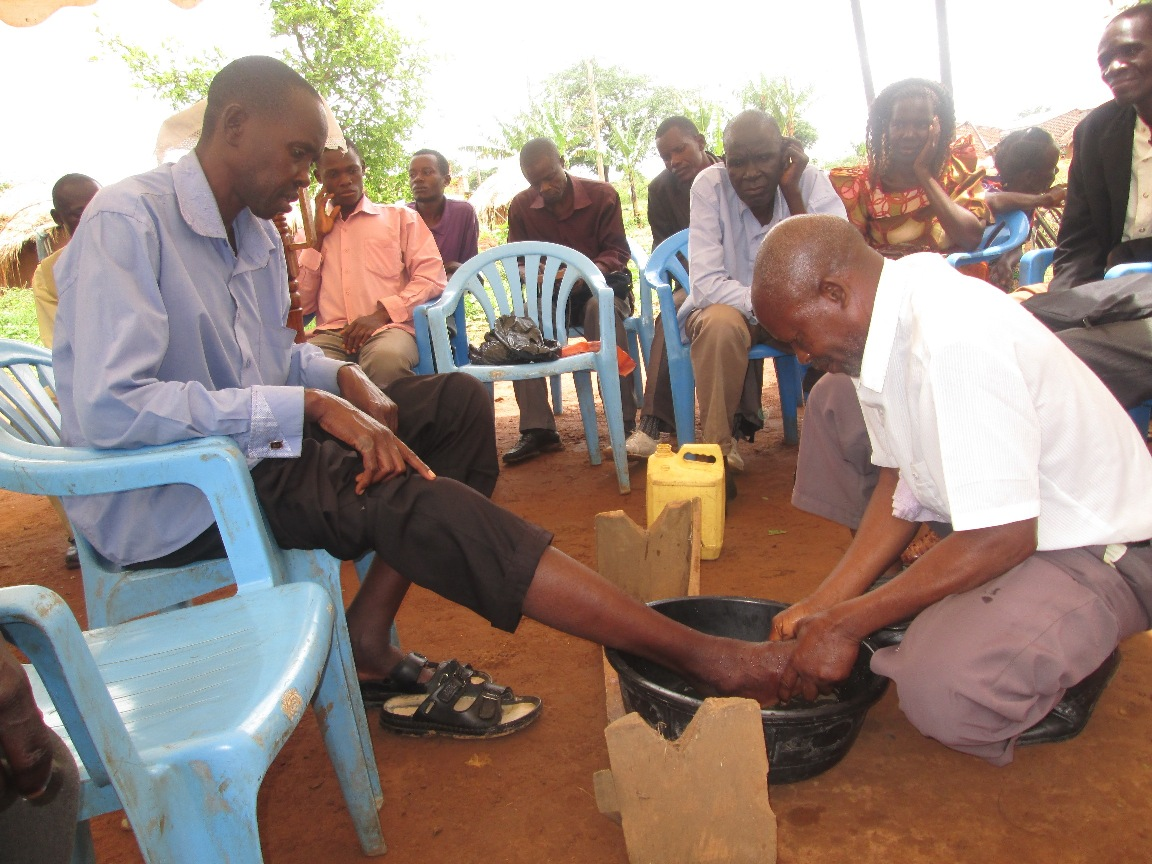 a village Pastor participates in Foot Washing