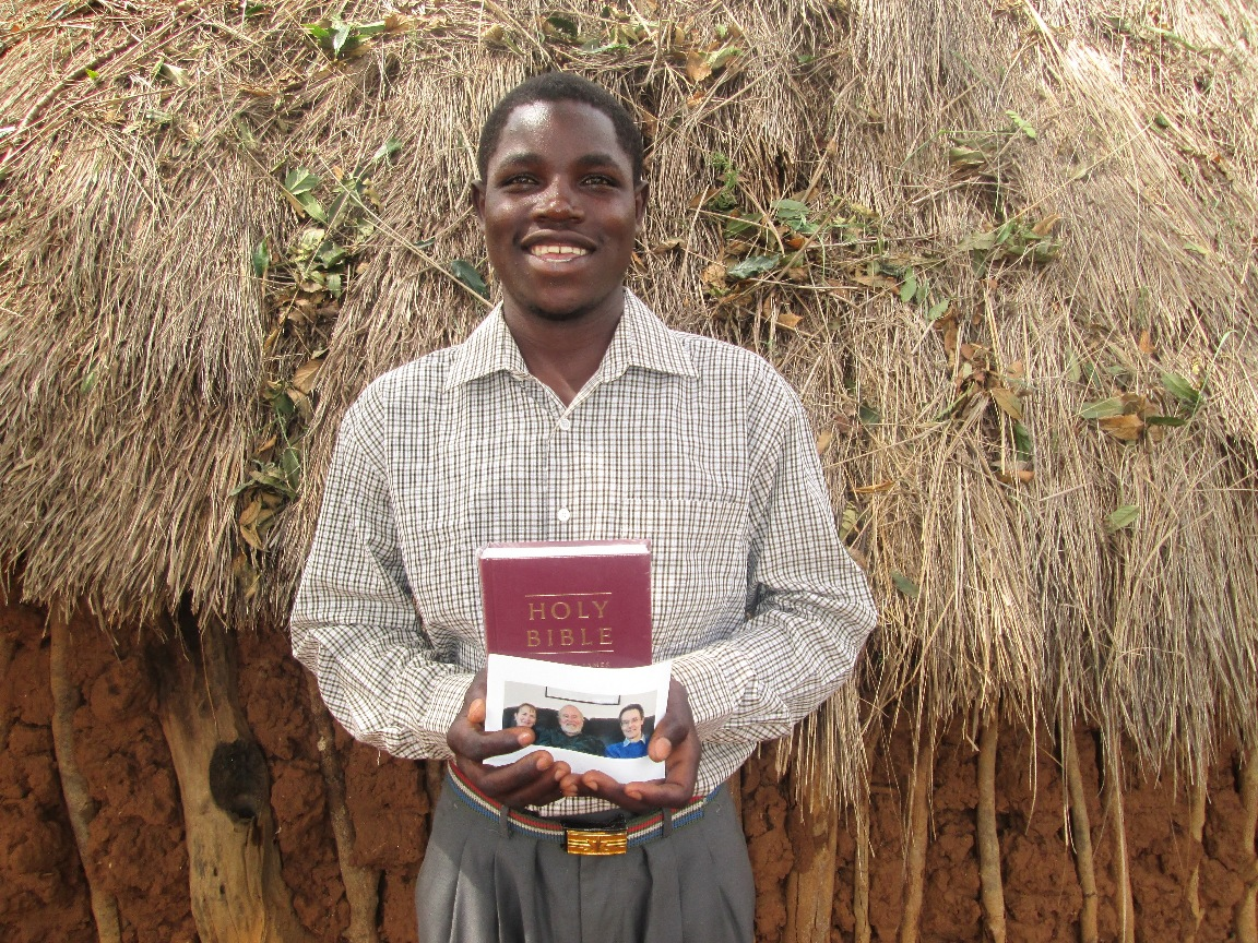 young man with his new English Bible----U.K. donors