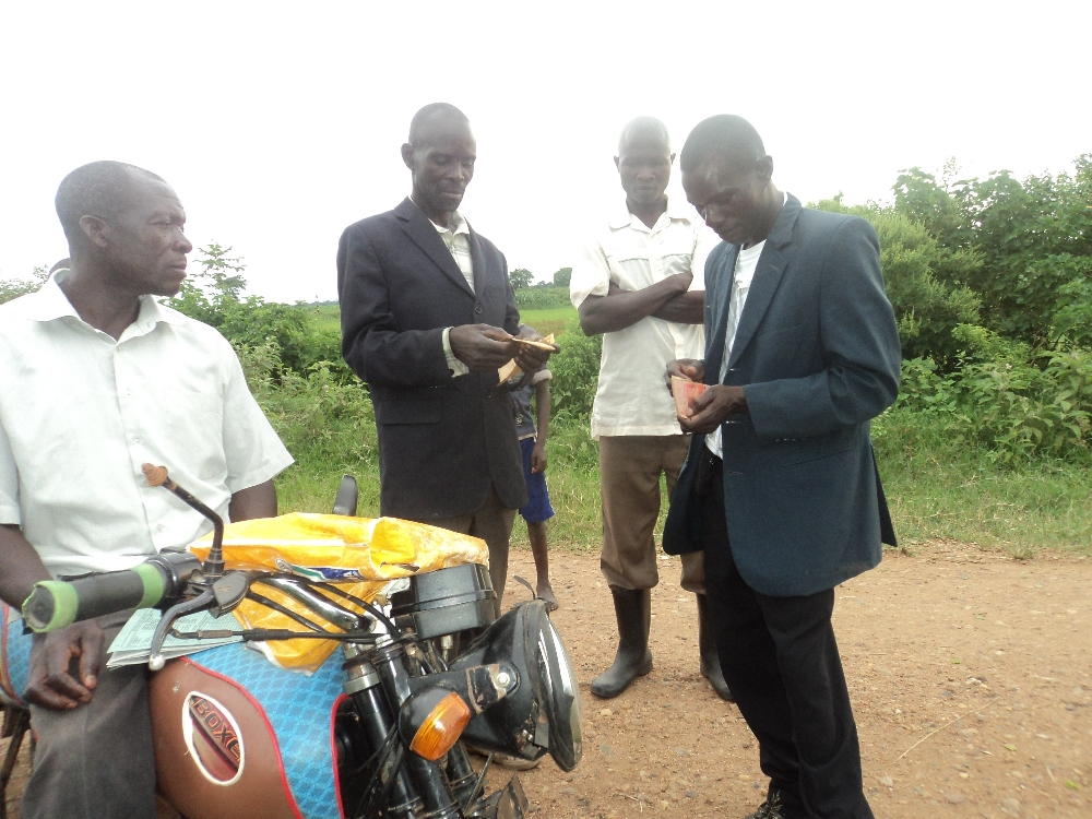Making payment for land----local magistrate witnessing transaction from motor-bike