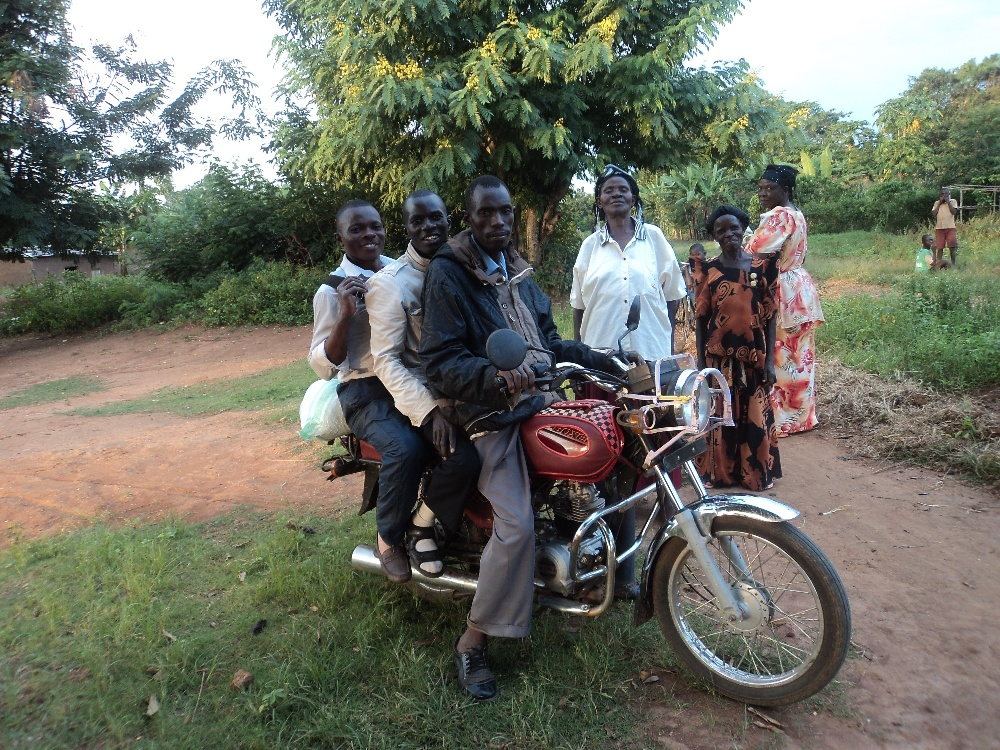 Joshua, Jimmy and driver leaving the village for home. Uganda Public Transportation--------always reliable!