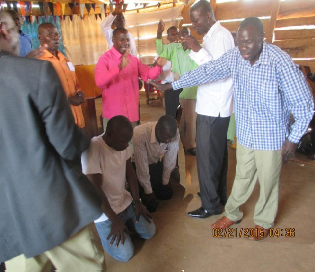 February 2015 Bukade The team praying for us after the conference..JPG