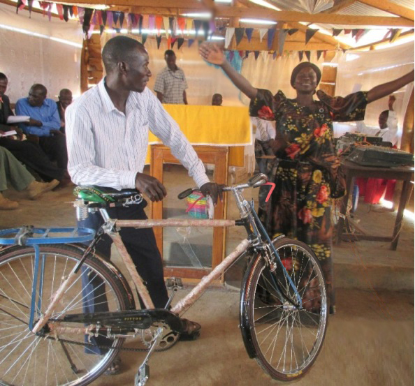 February 2015 Bugade bicycle recipient in praise.JPG