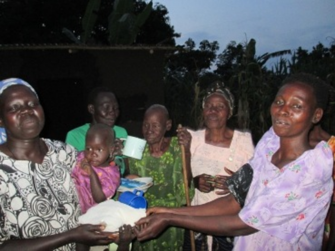 July 2015 Sister Sarah receiving some of her gift with great joy from the Church members..JPG
