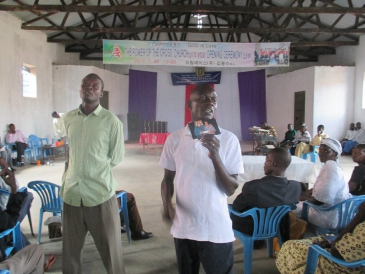 Buk Bishop Bita explains how bibles for Uganda gets its funds.JPG