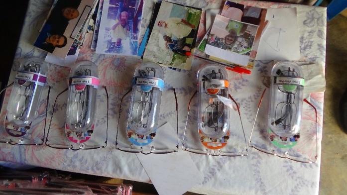 Dolme Dec Reading glasses ready for distribution.JPG
