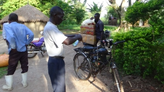 march 16 Making the bicycle ready for the final ride to Nabiyoga..JPG