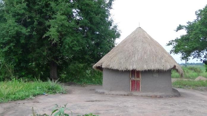 blind----Margrate's Mother (Rose) village rented hut..JPG