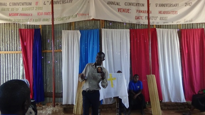 Dec 16 conference Bishop Bita explaining on the BFU donors and donations of bibles and other gifts. 2.JPG