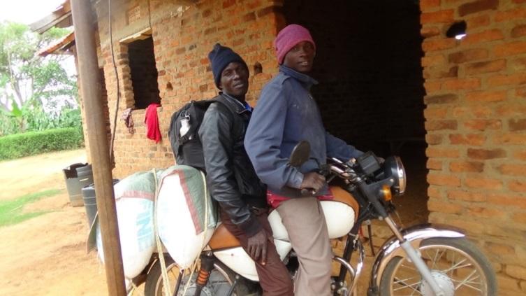 Bishop Bita arives in Namayingo with bags of posho.1.JPG