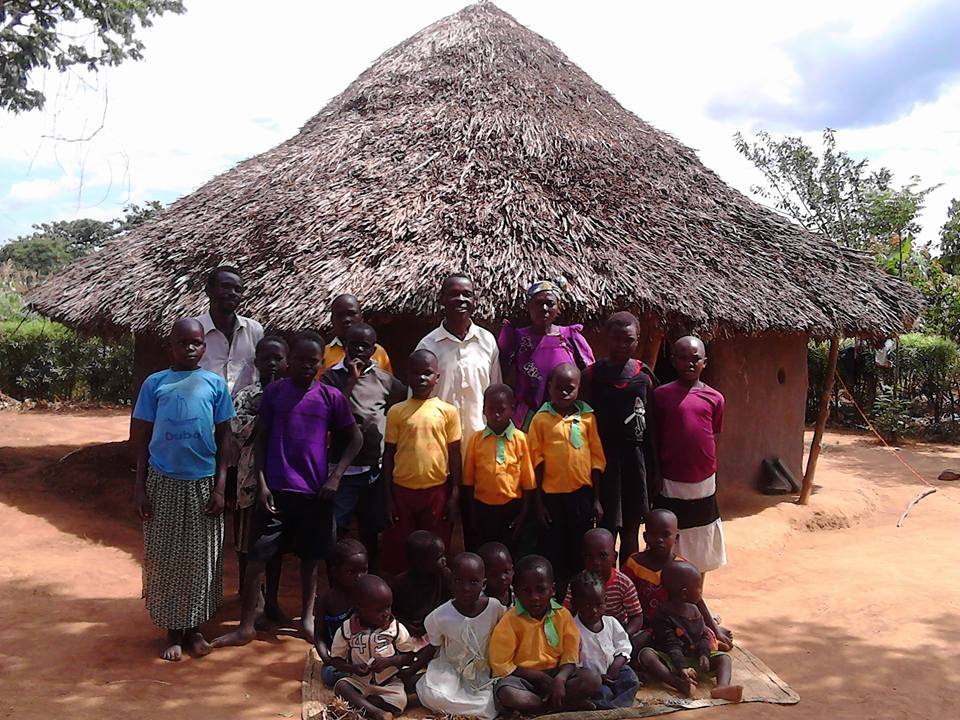 june Pastor Katandi middle(white shirt), mrs Katandi in a head covering and the children under their care. 1.jpg