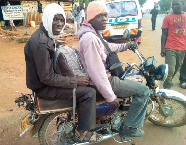 Jan Ariving in at Tororo taxi stage after a long dusty boda-boda ride..jpg