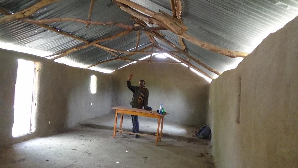 bcjc Pr Katandi inside the church house..JPG