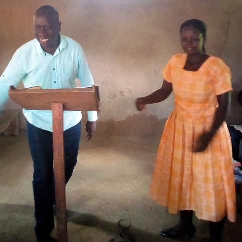 Buwanga Okurut teaching in our church opening sunday service2.jpg