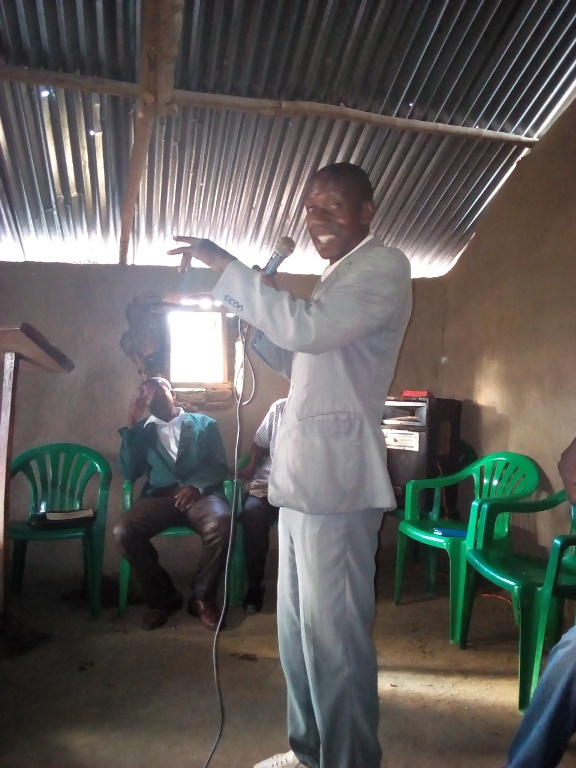 Buwanga Chaiman pastors fellowshhip gives his special thanks speech to NTFI ministry for restorering the only church in Buwanga. speaking on behalf of all the pastors..jpg