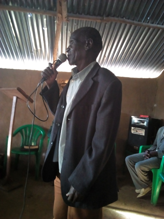 Buwanga Chairman LC1 giving his welcoming and special thanks remarks on behalf of Uaganda local governent to NTFI,BFU missionery team For restoring the only pentacostal church in his comunity..jpg