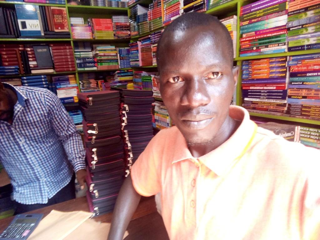 Bp Bita perchesings the bibles at the book stores in Kampala.1.jpg