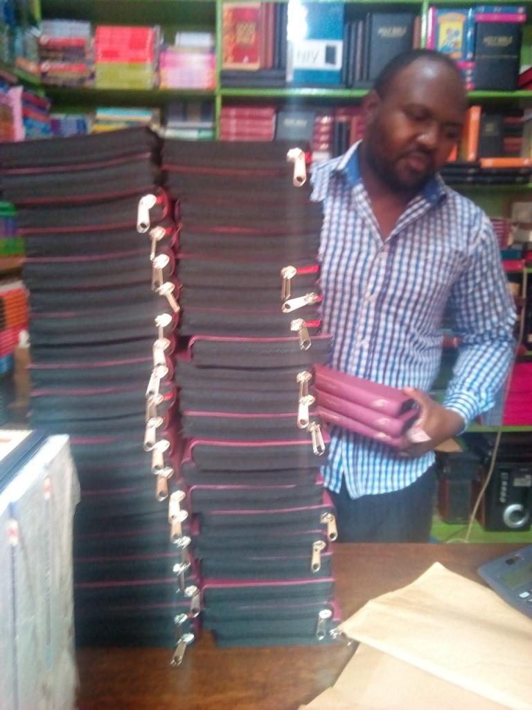Bp Bita perchesings the bibles at the book stores in Kampala.2.jpg
