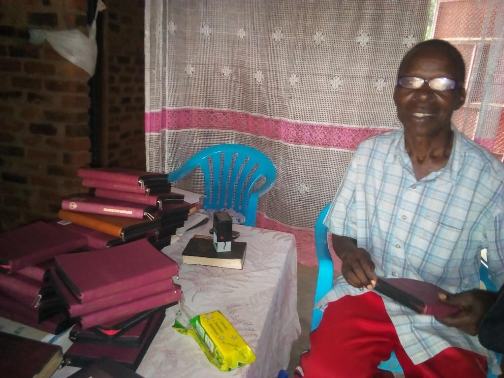Pr Katandi lebaling every bible by stamping on each.1.jpg