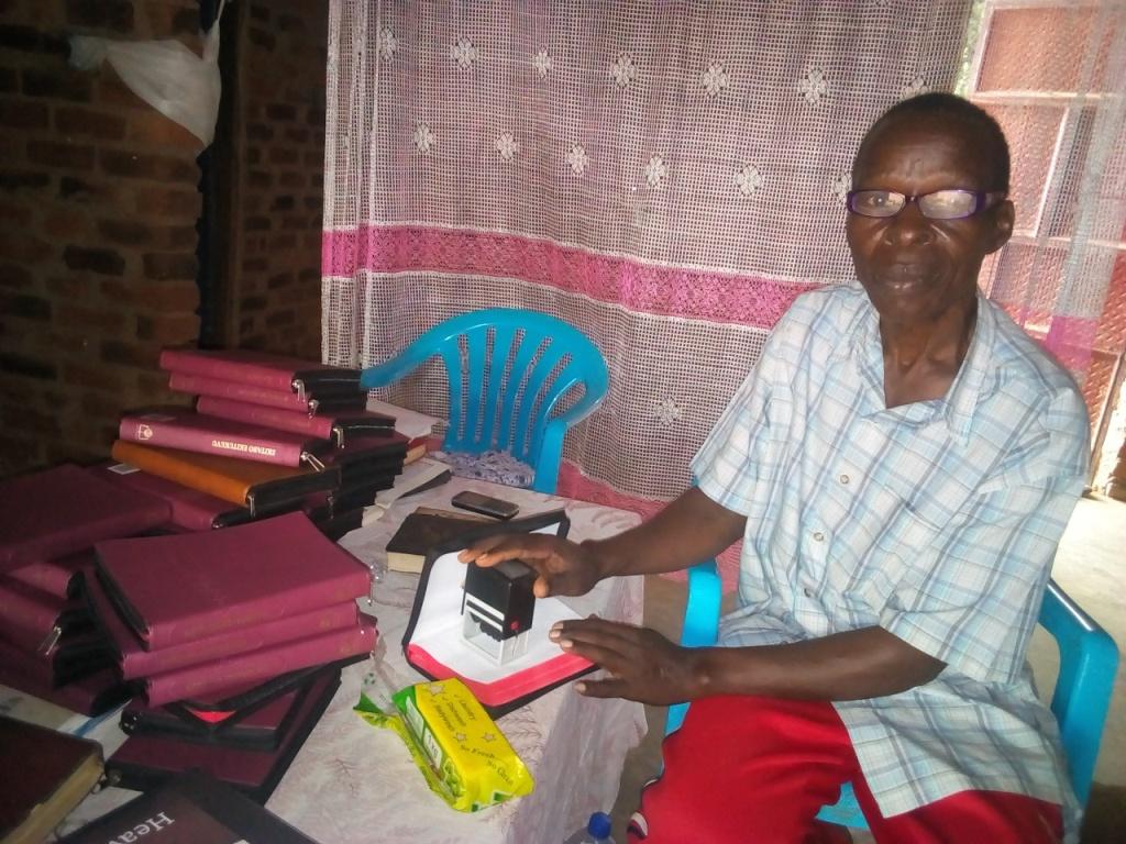 Pr Katandi lebaling every bible by stamping on each.2.jpg