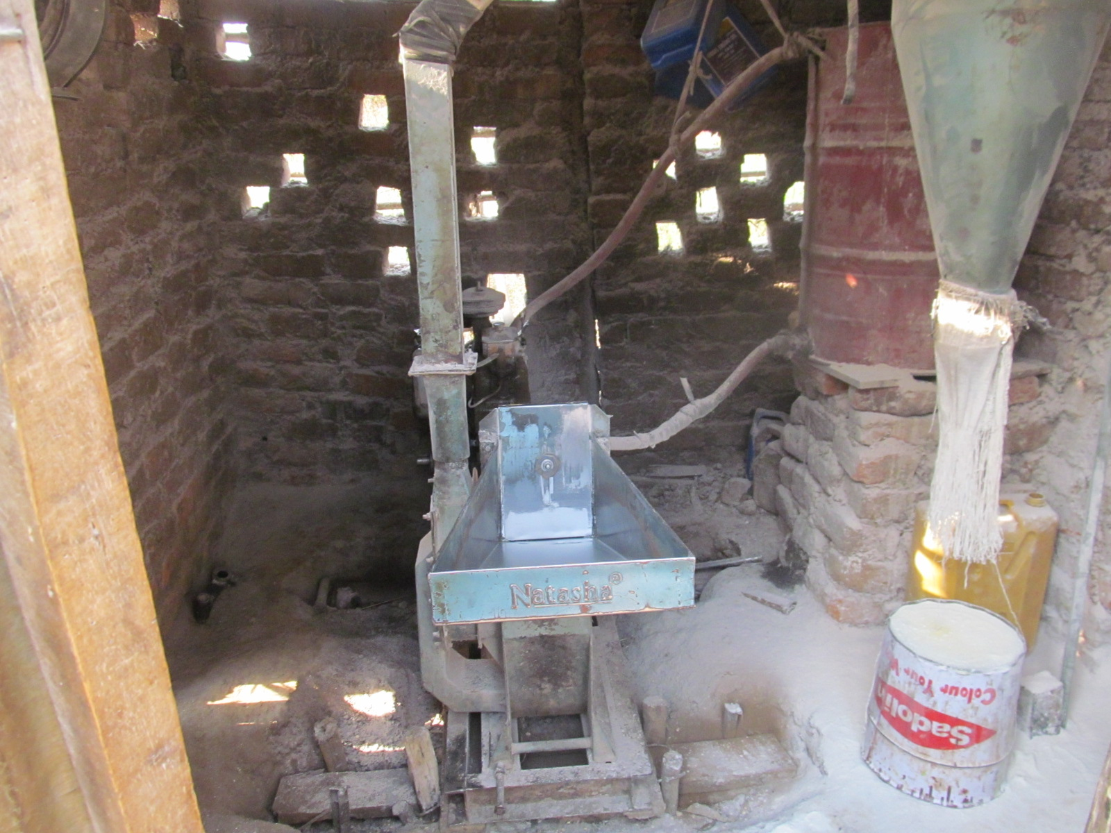 "Corn grinding mills purchased from the proceeds of the beads sold in the U.S. ""Gulu Beads""."