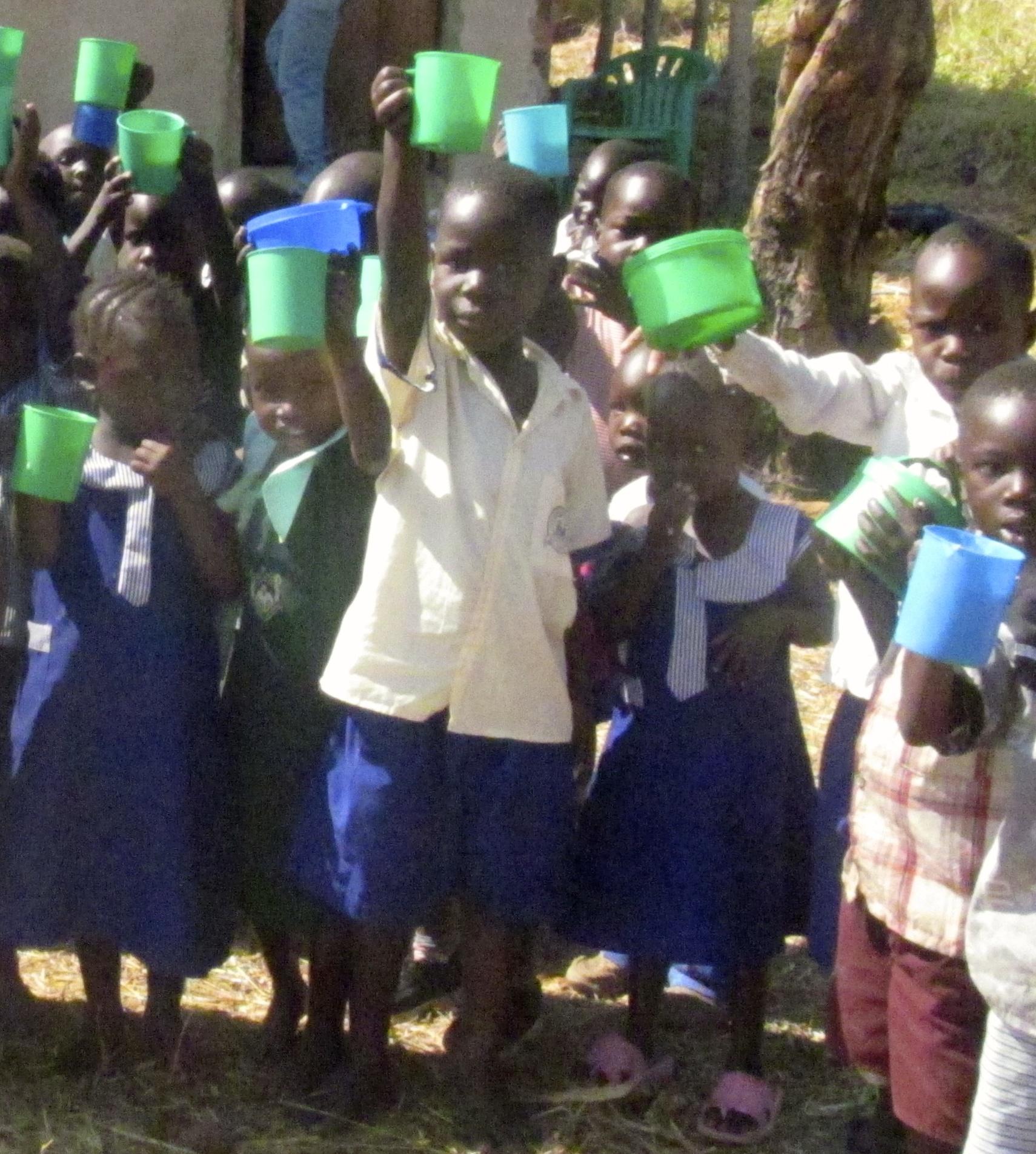 The children enjoying their porridge for lunch.