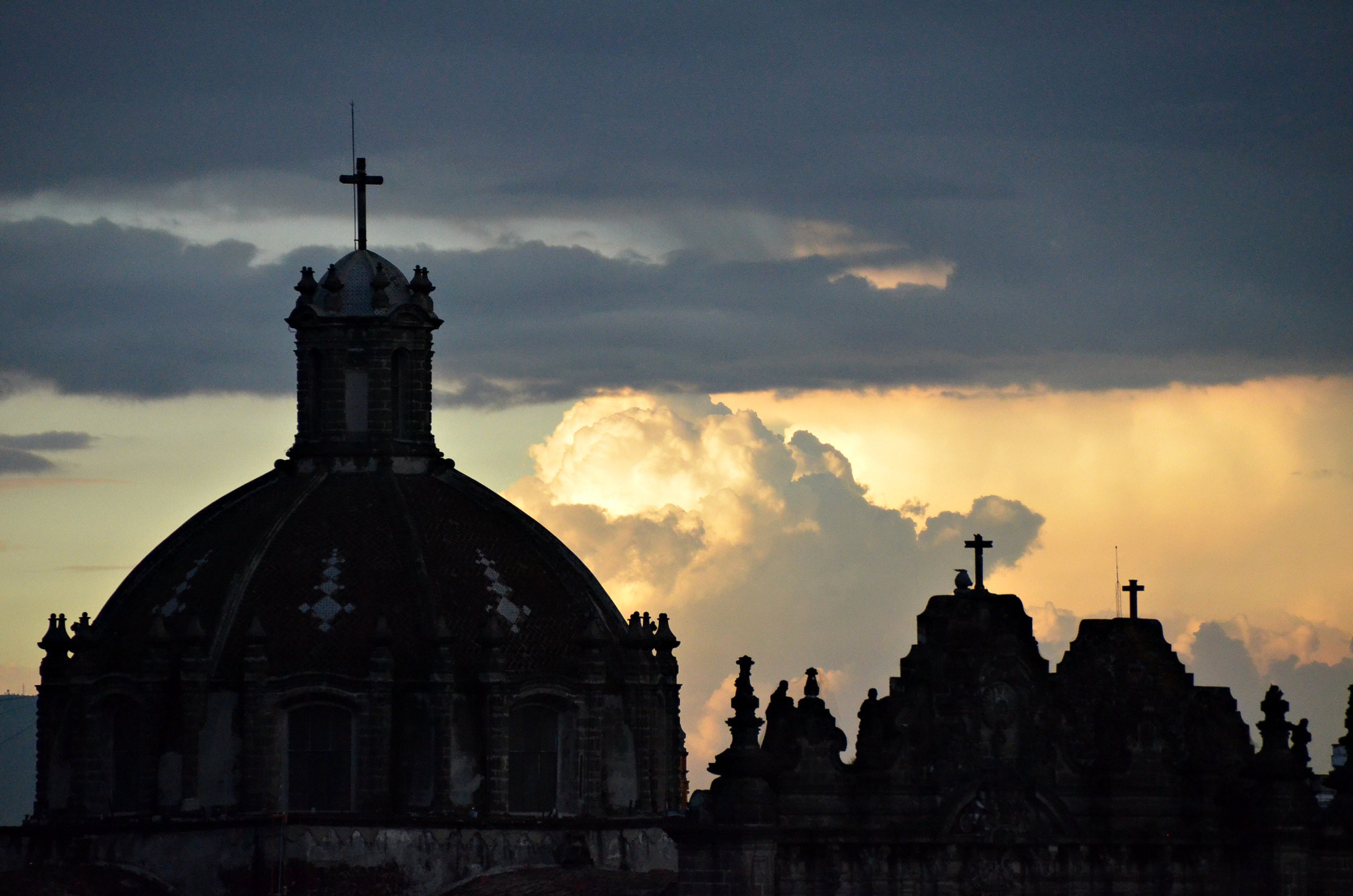 Gods of thunder roll past Mexico City's historic center; photo by Eric Beteille