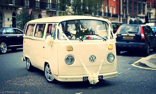 17 bridesmaids had a custom VW drop them off at St. Paul's church.