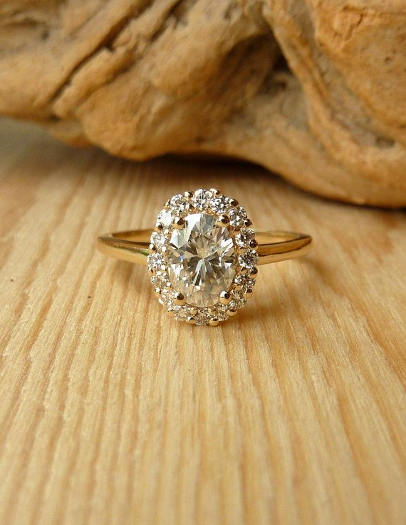 Oval Moissanite and Diamond Halo.