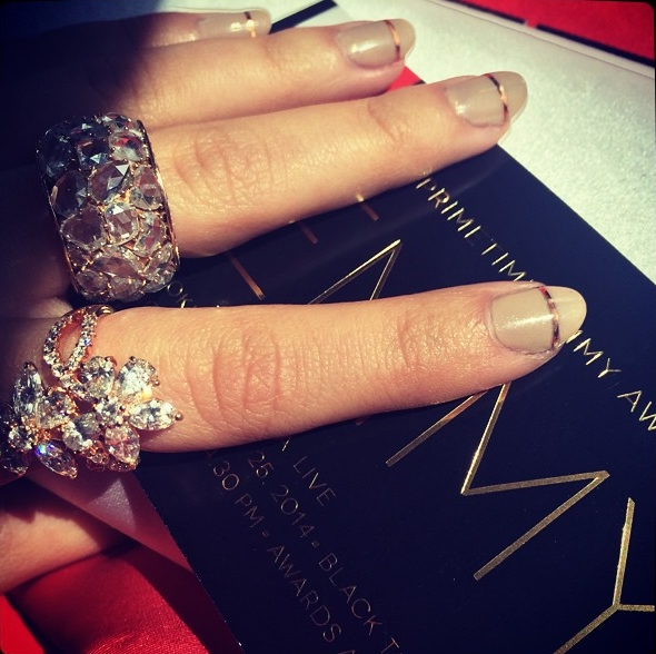 Sarah Hyland on her way to the Emmys. Showing off her shiny diamond rings.
