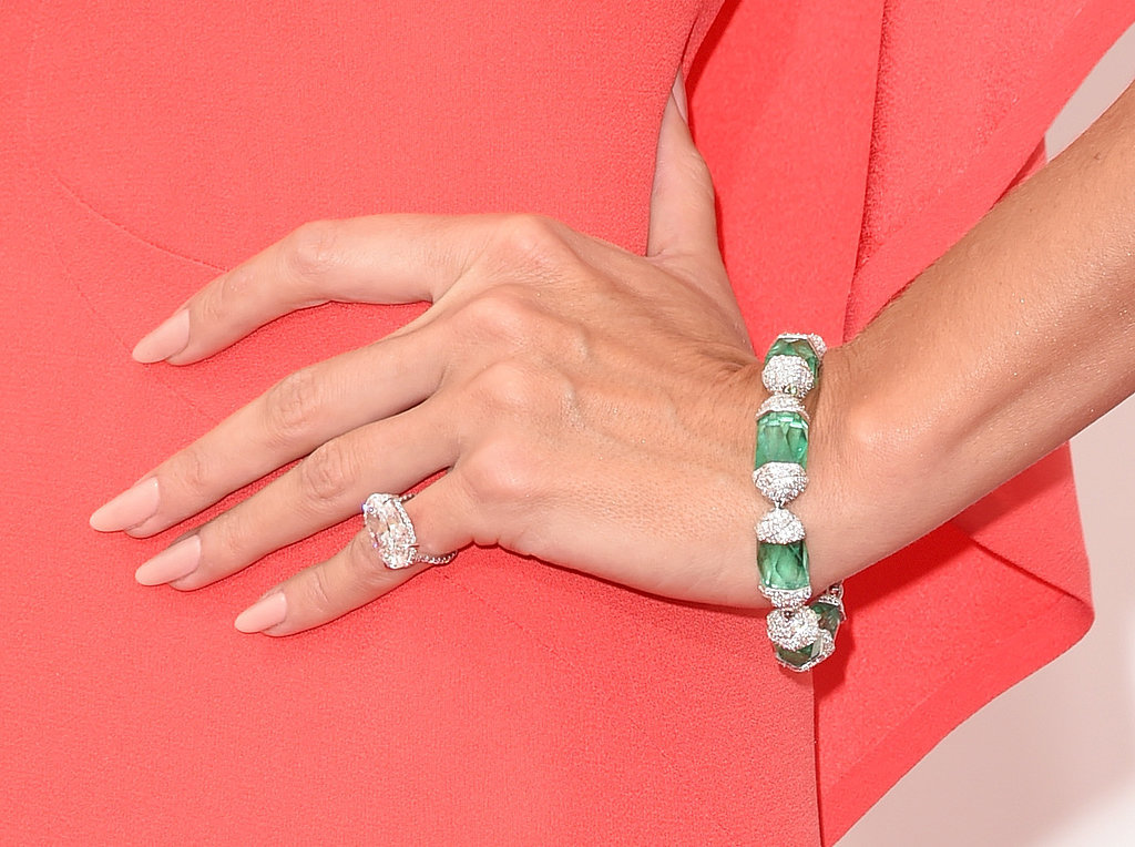 DIamond ring and statement bracelet with green stones.