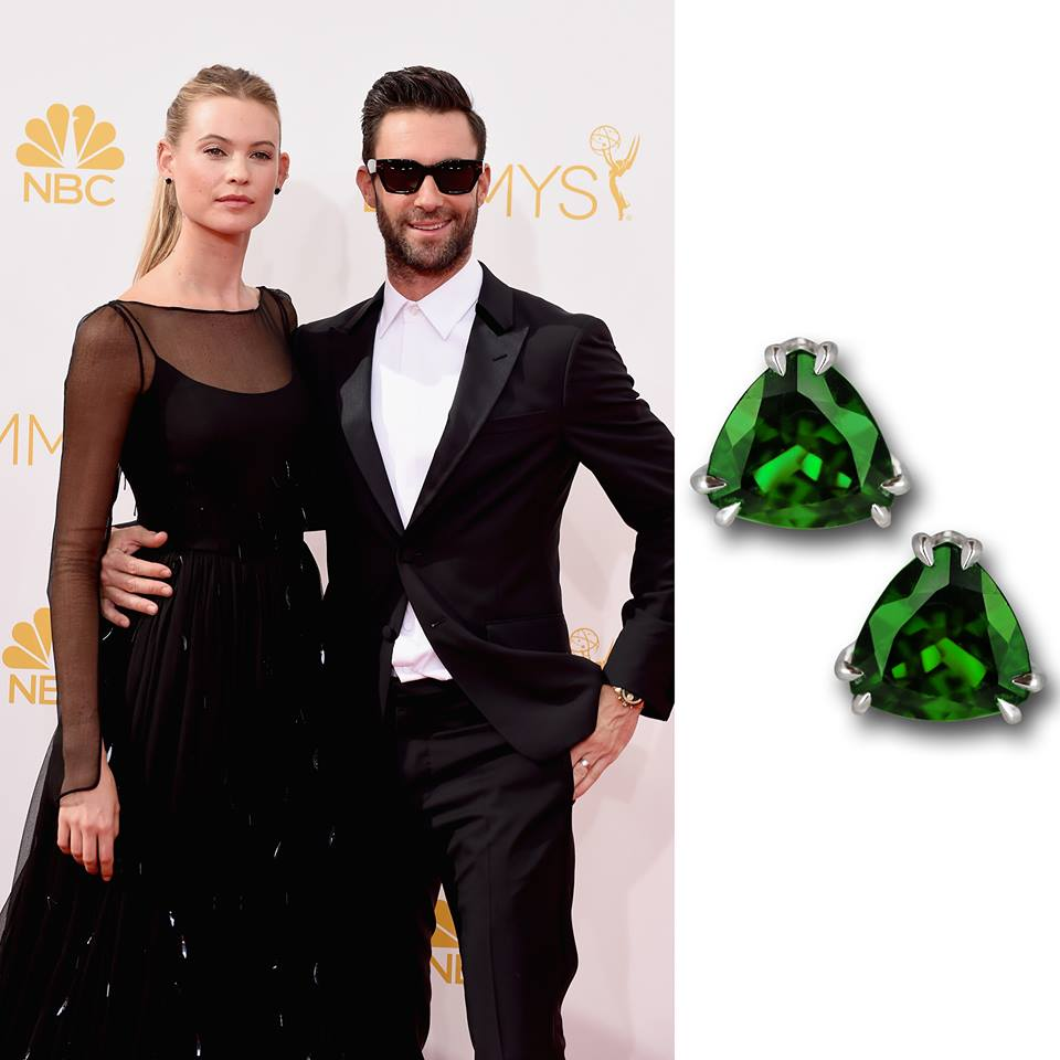 Behati Prinsloo and Adam Levine rocking their black and white looks popping some color with Jacob & Co. special cut favorite studs.