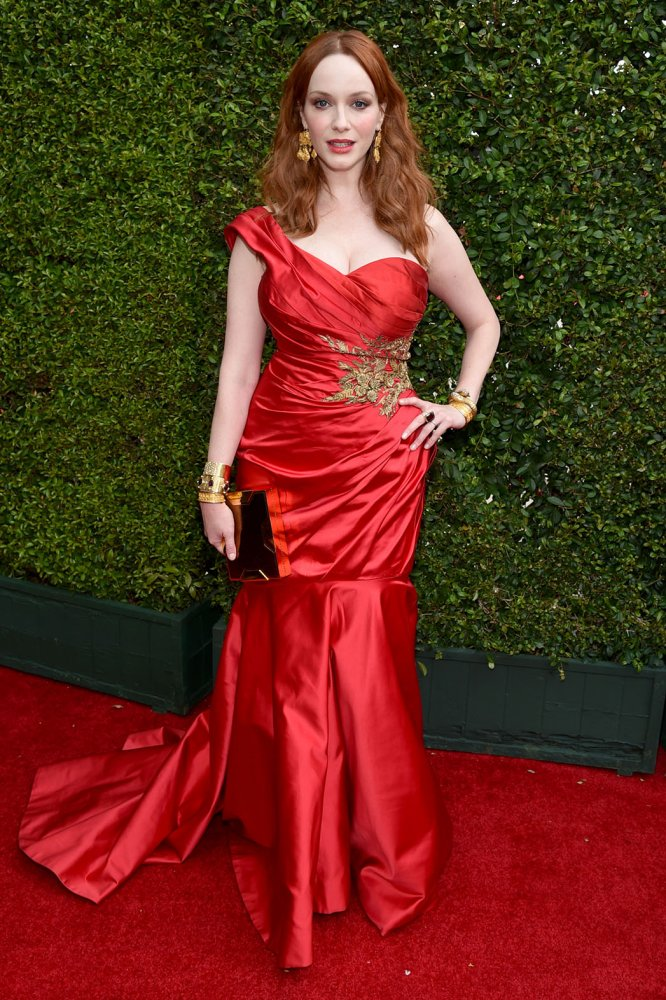 Red hot! Mad Men star Christina Hendricks chose a gorgeous duchess satin one-shoulder gown with floral embroidery by Marchesa.