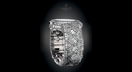 encrusted with 1,200 diamonds weighing 140 carats in all. These include six stones that each weigh at least three carats.