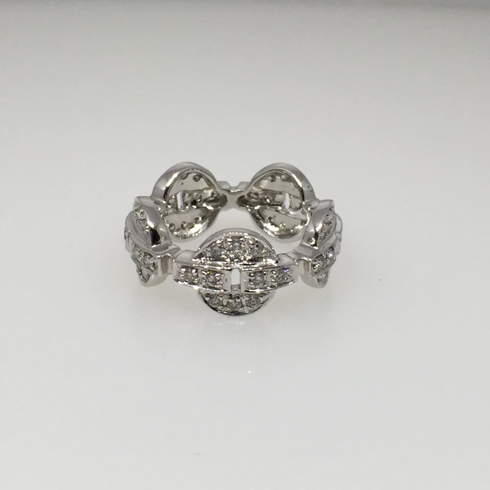 18 Karat White Gold Ring. Diamonds: .75 tw Round.