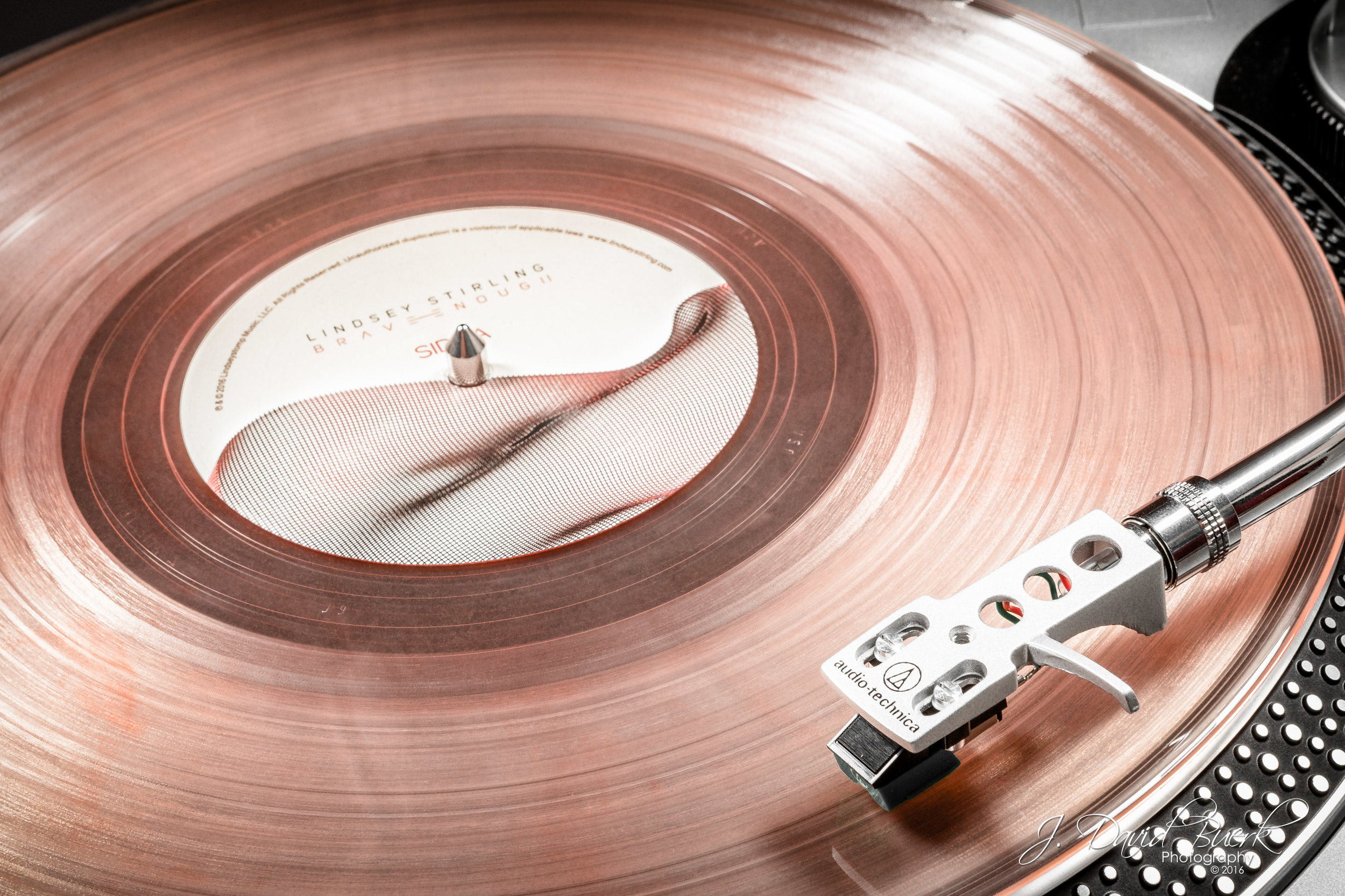 "A limited edition Translucent Pink autographed Lindsey Stirling ""Shatter Me"" 33 RPM vinyl on an Audio-Technica turntable."