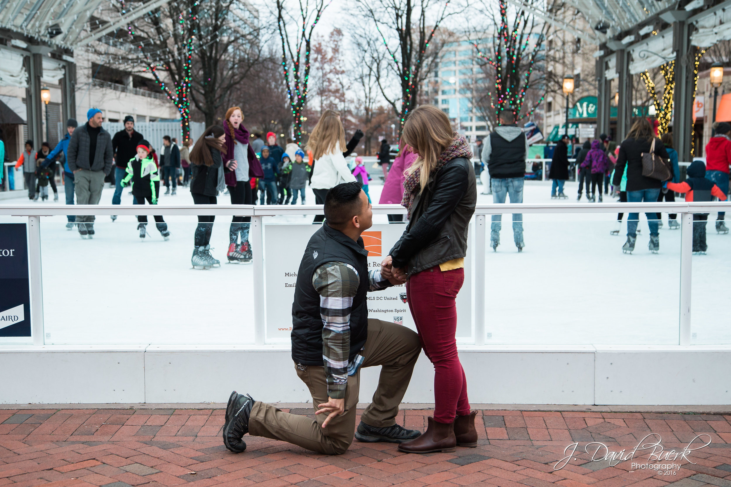 Leo surprises Chelsea with a marriage proposal at the skating rink at Reston Town Center, Reston, Virginia.  She said yes!