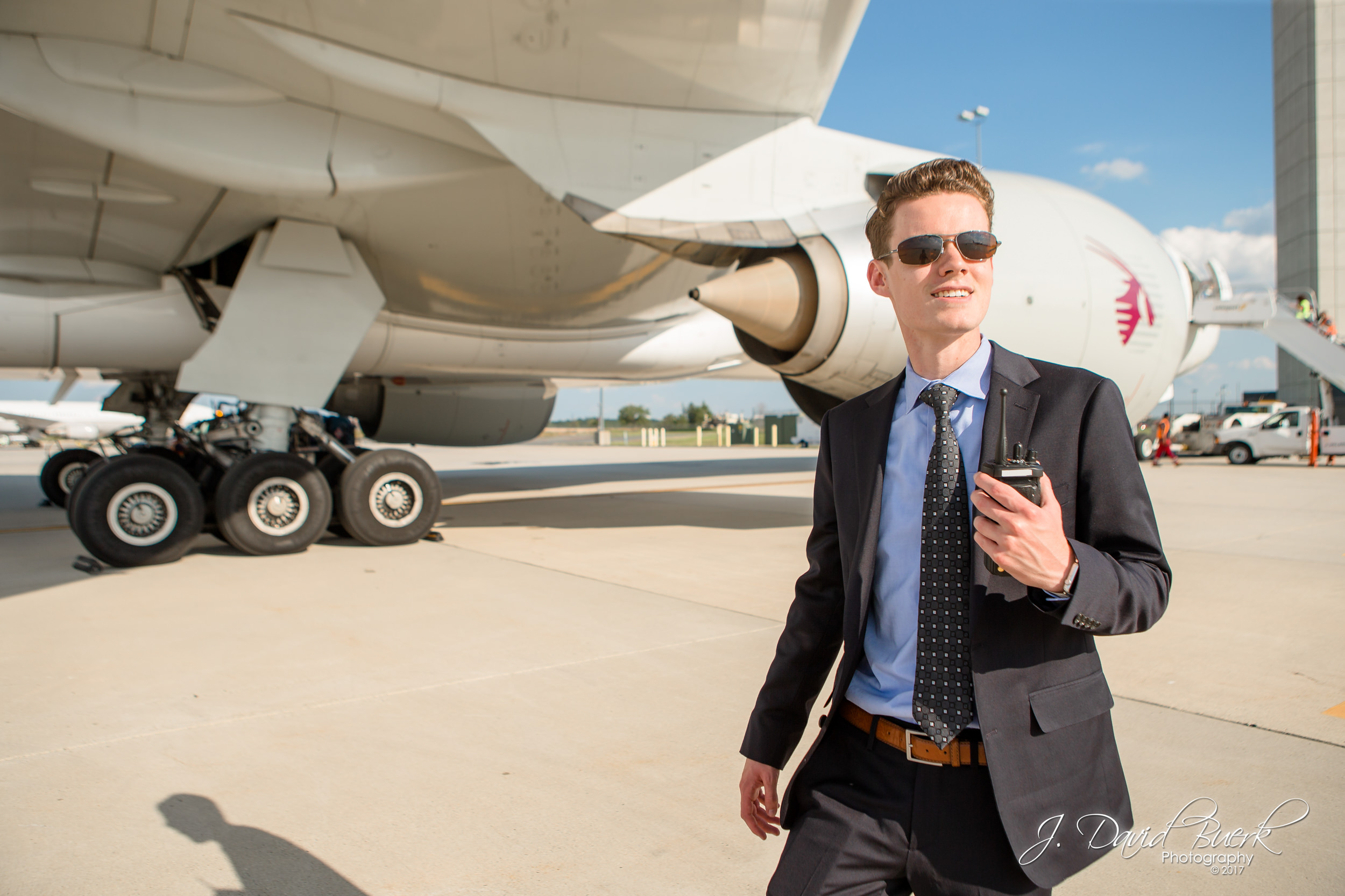 Ryan Ewing, owner and founder of AirlineGeeks.com, walks on the airfield at Washington Dulles International Airport.
