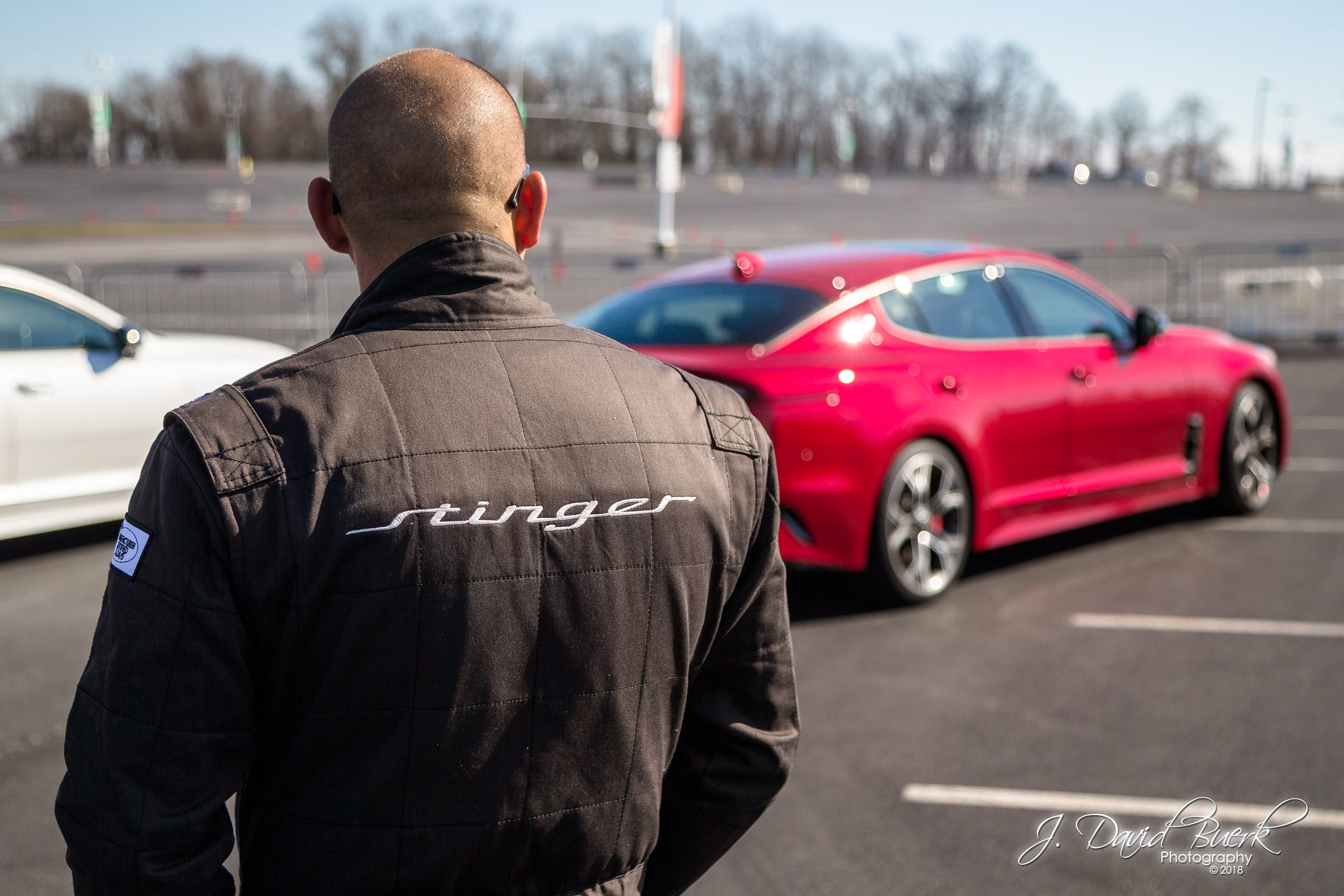 A driving instructor watches the autocross track during The Kia Stinger Experience Tour, Washington, DC, March 10th, 2018.